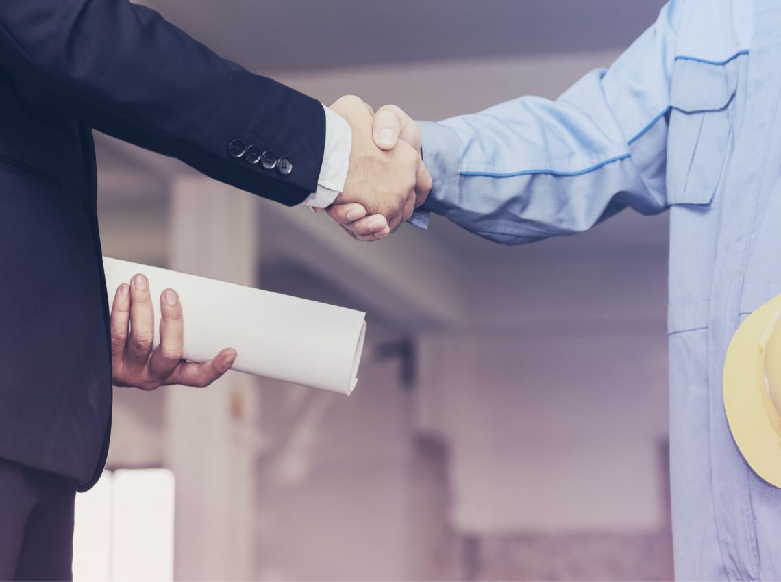 architect-engineer-shaking-hands-with-businessman-site